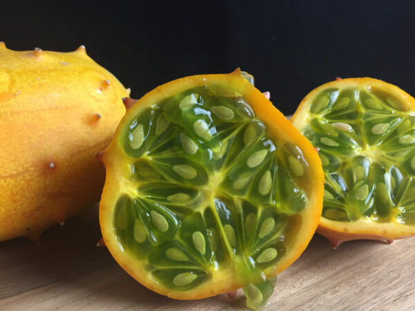 African horned cucumber cut in half showing green seeds