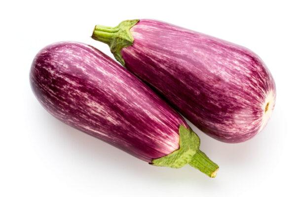 Two Tsakoniki eggplants alone on a white background
