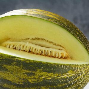 Piel De Sapo rockmelon with a quater of it cut our to show the light flesh