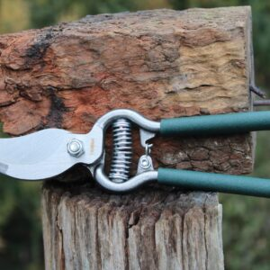 forged shears displayed on a log