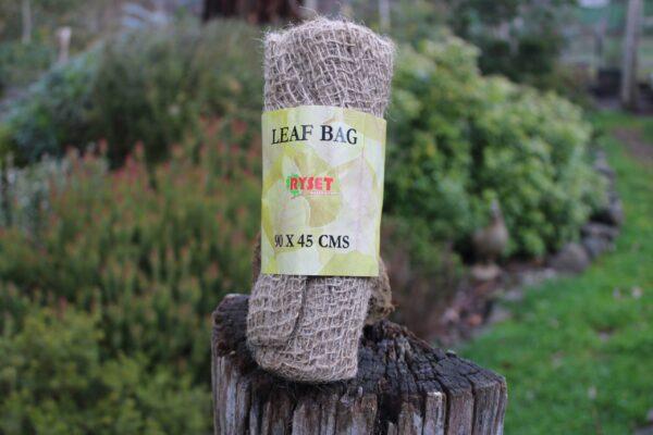 Leaf Bag displayed on an upright log