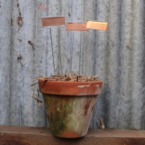 Copper Labels in a pot in front of rustic tin