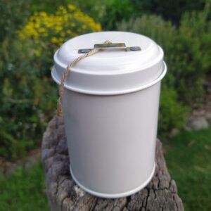 White Twine in a Tin on a log